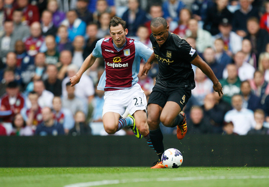 Aston Villa's Libor Kozak (L) and Manchester City's Vincent Kompany in action during todays match  <br /> <br /> Photo by Jack Phillips/CameraSport<br /> <br /> Football - Barclays Premiership - Aston Villa v Manchester City - Saturday 28th September 2013 - Villa Park - Birmingham<br /> <br /> &copy; CameraSport - 43 Linden Ave. Countesthorpe. Leicester. England. LE8 5PG - Tel: +44 (0) 116 277 4147 - admin@camerasport.com - www.camerasport.com