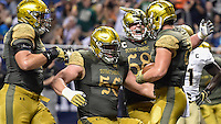 Durham Smythe (80) celebrates with offensive lineman Quenton Nelson (56) and offensive lineman Mike McGlinchey (68) after a touchdown in the second quarter.