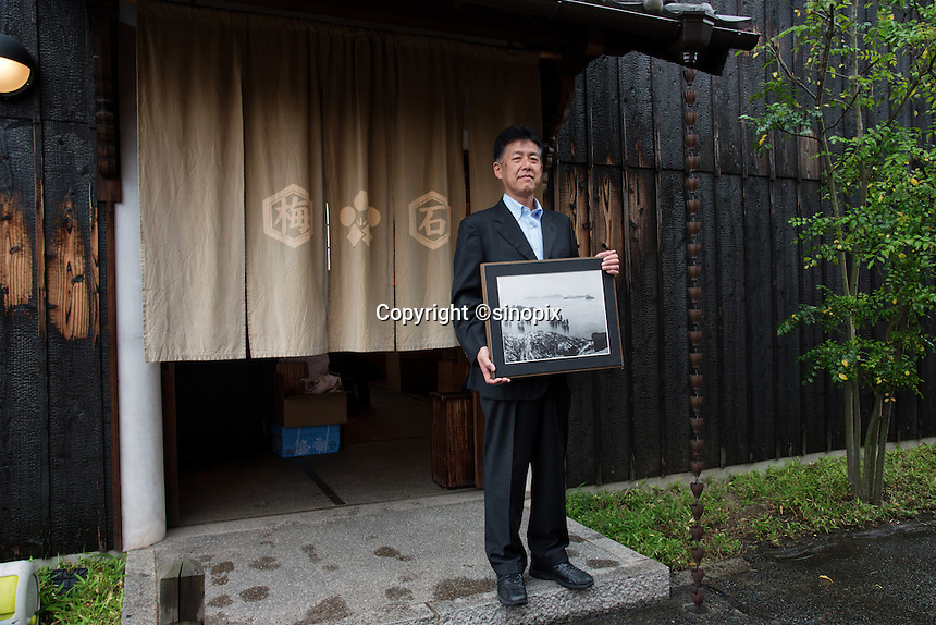 MAY 15, 2014 - KURASHIKI, JAPAN: President of Takeyari pose for camera in front of  BYSTONE store   .  (Photograph / Ko Sasaki)