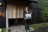 MAY 15, 2014 - KURASHIKI, JAPAN: President of Takeyari pose for camera in front of  BYSTONE store   .  (Photograph / Ko Sasaki)