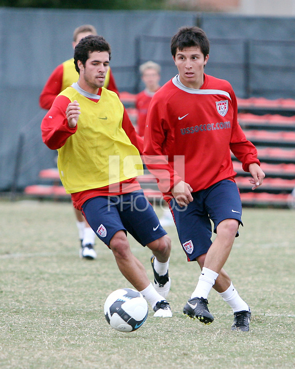 Jose Francisco Torres of USA men's national team passes the ball in front of Benny Feilhaber during a practice session before the final CONCACAF 2010 World Cup qualifying match at RFK practice facility, on October12 2009, in Washington D.C.
