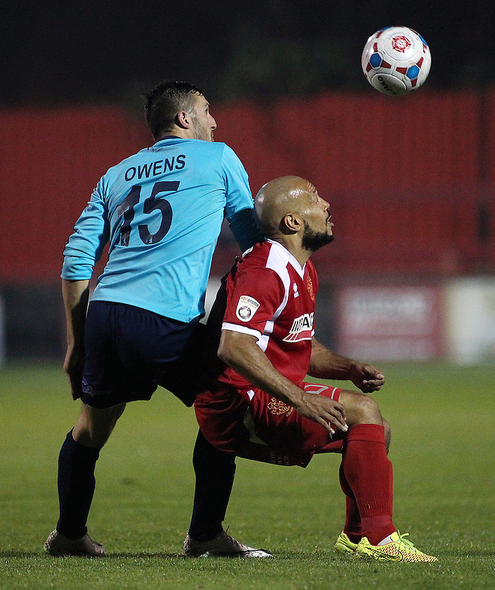AFC Telford United's Andrew Owens and Alfreton Town's Karl Hawley vie for possession <br /> <br /> Photo by Rich Linley/CameraSport<br /> <br /> Football - English Football Vanarama Conference Premier League - Alfreton Town v AFC Telford United - Tuesday 16th September 2014 - Impact Arena - Alfreton<br /> <br /> &copy; CameraSport - 43 Linden Ave. Countesthorpe. Leicester. England. LE8 5PG - Tel: +44 (0) 116 277 4147 - admin@camerasport.com - www.camerasport.com