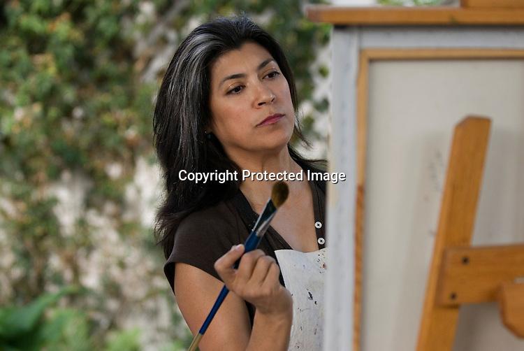 Hispanic woman painting