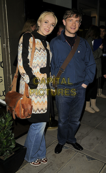 AMANDA ABBINGTON & MARTIN FREEMAN.The UGG Australia: London Store Launch in Covent Garden, London, England. .November 26th, 2008 .full length couple jeans denim blue jacket holding hands white pattern coat bag purse brown .CAP/CAN.©Can Nguyen/Capital Pictures.
