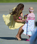 July 7, 2011 - Calgary, Alberta, Canada - Catherine Middleton, Duchess of Cambridge, is greeted by Diamond Marshall, age 6, who is battling cancer, as the pair arrive in Calgary. Calgary is the last Canadian stop of the British Royal Tour. Photo by Jimmy Jeong / Rogue Collective