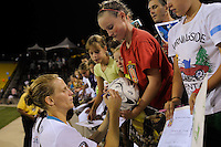 Kristine Lilly (13) of Marta XI signs autographs after the Women's Professional Soccer (WPS) All-Star Game at KSU Stadium in Kennesaw, GA, on June 30, 2010.