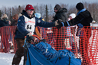 Timothy Hunt team leaves the start line during the restart day of Iditarod 2009 in Willow, Alaska