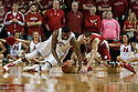 March 9, 2014: Leslee Smith (21) of the Nebraska Cornhuskers and Josh Gasser (21) of the Wisconsin Badgers go after a loose ball at the Pinnacle Bank Arena, Lincoln, NE. Nebraska 77 Wisconsin 68.