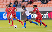 HOUSTON, TX - FEBRUARY 3: Melchie Dumonay #6 of Haiti dribbles past Marta Cox #11 of Panama during a game between Panama and Haiti at BBVA Stadium on February 3, 2020 in Houston, Texas.