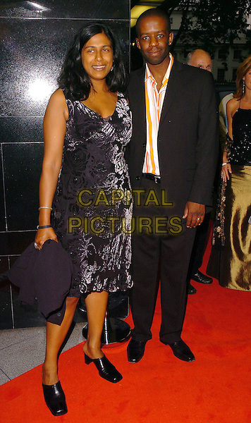 ADRIAN LESTER & GUEST.CRE Race in the Media Awards, .London, June 28th 2005..full length adrien.Ref: CAN.www.capitalpictures.com.sales@capitalpictures.com.©Can Nguyen/Capital Pictures