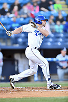 Asheville Tourists designated hitter Chad Spanberger swings at a pitch during a game against the Rome Braves at McCormick Field on April 17, 2018 in Asheville, North Carolina. The Tourists defeated the Braves 1-0. (Tony Farlow/Four Seam Images)