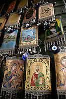 Christian iconography and evil eyes for sale at the Egyptian Spice Bazaar, Istanbul Turkey