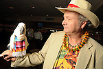Bob Bednar and Peachy Boy at the Cinco de Mayo themed reception held by Siemens at the West Club in Reliant Stadium Wednesday May 2,2012. (Dave Rossman Photo)
