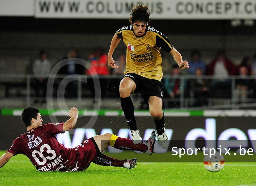 SV Zulte-Waregem - KV Kortrijk : Pablo Chavarria probeert de tackle te ontwijken van Steve Colpaert.foto VDB / BART VANDENBROUCKE
