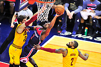 John Wall of the Wizards shoots an acrobatic shot against Cavaliers Kyle Korver. Cleveland Cavaliers defeated Washington Wizards in OT 140-135 during a game at the Verizon Center in Washington, D.C. on Monday, February 6, 2017.  Alan P. Santos/DC Sports Box