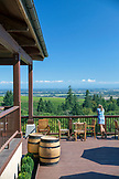 USA, Oregon, Willamette Valley, a young woman takes in the view of the Willamette Valley at Domaine Drouhin Winery, Dundee
