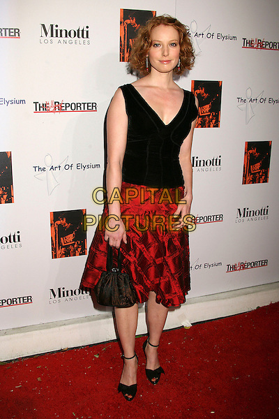 ALICIA WITT.The 2006 Art of Elysium Annual Art,  Benefit at Minotti, Los Angeles, California, USA,.02 December 2006..full length black top red skirt.CAP/ADM/BP.©Byron Purvis/AdMedia/Capital Pictures.