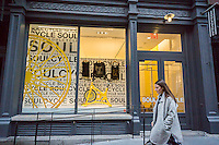 A branch of the widely popular SoulCycle exercise studio in the Soho neighborhood of New York on Saturday, December 12, 2015. SoulCycle, the chain of indoor cycling exercise clubs, has filed for an initial public offering hoping to raise up to $100 million. (© Richard B. Levine)