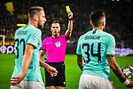 05.11.2019, Signal Iduna Park, Dortmund , GER, Champions League, Gruppenphase, Borussia Dortmund vs Inter Mailand, UEFA REGULATIONS PROHIBIT ANY USE OF PHOTOGRAPHS AS IMAGE SEQUENCES AND/OR QUASI-VIDEO<br /> <br /> im Bild | picture shows:<br /> Referee | Schiedsrichter Danny Makkiele (NED) zeigt Milan Skriniar (Inter #37) nach dessen Foul an Achraf Hakimi (Borussia Dortmund #5) die gelbe Karte, <br /> <br /> Foto © nordphoto / Rauch
