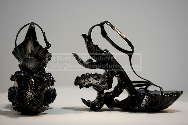 21/06/2012. LONDON, UK. A pair of Alexander McQueen shoes (Est: £3,000--6,000) are seen at Christies South Kensington Auction House in London today (21/0612) ahead of a charity auction.  The auction, held in aid of The Isabella Blow Foundation, features 102 lots of shoes, clothes and photographs from Daphne Guinness's private collection and is expected to realise in the region of £100,000 when it takes place on the evening of the 27th of June. Photo credit: Matt Cetti-Roberts