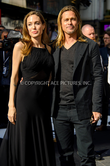 WWW.ACEPIXS.COM<br /> <br /> US Sales Only<br /> <br /> June 2 2013, London<br /> <br /> Angelina Jolie and Brad Pitt at the premiere of 'World War Z' held at the Empire Leicester Square on June 2 2013 in London<br /> <br /> By Line: Famous/ACE Pictures<br /> <br /> <br /> ACE Pictures, Inc.<br /> tel: 646 769 0430<br /> Email: info@acepixs.com<br /> www.acepixs.com