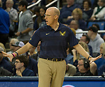 Akron head coach John Groce works the sidelines against Nevada in the first half of an NCAA college basketball game in Reno, Nev., Saturday, Dec. 22, 2018. (AP Photo/Tom R. Smedes)