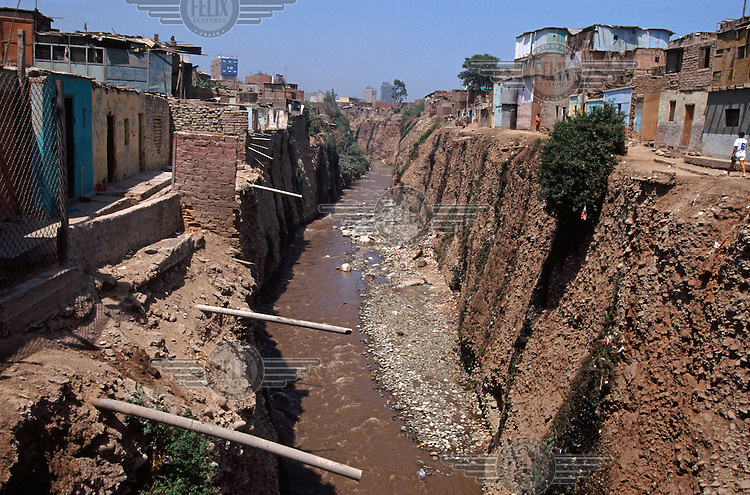 Raw sewage draining into a river in Lima.