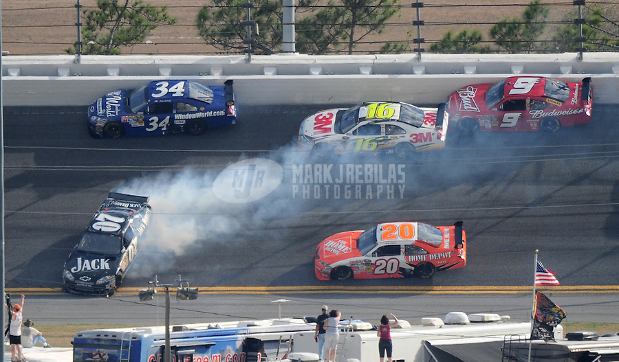 Feb 12, 2009; Daytona Beach, FL, USA; Nascar Sprint Cup Series driver Casey Mears (07) spins after contact with Joey Logano (20) during race one of the Gatorade Duel at Daytona International Speedway. Mandatory Credit: Mark J. Rebilas-