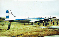 BNPS.co.uk (01202 558833)<br /> Pic: DNW/BNPS<br /> <br /> The Argentine DC-4 aircraft on the race course at Stanley in the Flaklands. <br /> <br /> The incredible tale of Argentina's little known first invasion of the Falklands islands revealed as Royal Marine heroes medals are sold.<br /> <br /> The medal group of a Royal Marine who was taken hostage by Argentinian terrorists when they tried to claim the Falklands 16 years before the war are being sold.<br /> <br /> Major Alan Wiles was serving as a PT instructor for the Dad's Army-like Falkland Islands Defence Force when a hijacked Argentine airliner landed on the racecourse at Stanley. <br /> <br /> Thinking the Douglas DC-4 plane was in distress the British army officer, who was trout fishing at the time, rushed to the scene only to be met by 18 armed hijackers.<br /> <br /> The El Condor group, that had forced the pilot at gunpoint to divert 400 miles to the Falklands, raised the Argentine flag and demanded Britain recognised the islands as their country's.<br /> <br /> They surrendered less than 24 hours later.<br /> <br /> Now Maj Wiles medals are coming up for auction in London.