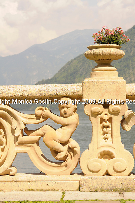 The the stone railings with baby angels in the gardens of Villa del Balbianello on Lake Como, Italy.