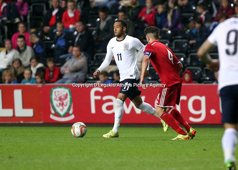 Pictured L-R: Nathan Redmond of England closely followed by Lee Lucas of Wales. Monday 19 May 2014<br /> Re: UEFA Euro Under-21 Qualifier, Wales v England at the Liberty Stadium, Swansea, south Wales, United Kingdom