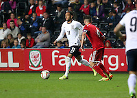 Pictured L-R: Nathan Redmond of England closely followed by Lee Lucas of Wales. Monday 19 May 2014<br />