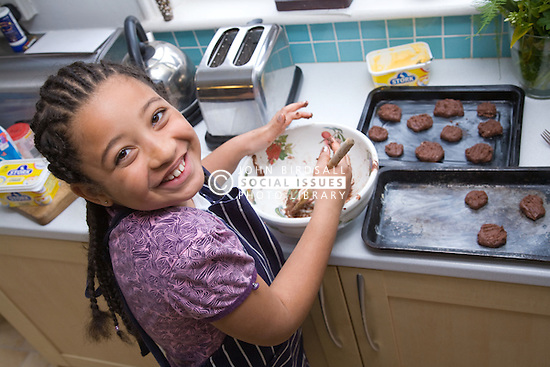 Little girl making some biscuits,