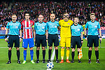 (From left) Additional assistant referee Sergei Ivanov, Diego Roberto Godin Leal of Atletico de Madrid, assistant referee Tikhon Kalugin, referee Sergei Karasev, goalkeeper Bernd Leno of Bayer 04 Leverkusen, assistant referee Anton Averianov and additional assistant referee Sergei Lapochkin pose for a photo prior to the 2016-17 UEFA Champions League Round of 16 second leg match between Atletico de Madrid and Bayer 04 Leverkusen at the Estadio Vicente Calderon on 15 March 2017 in Madrid, Spain. Photo by Diego Gonzalez Souto / Power Sport Images