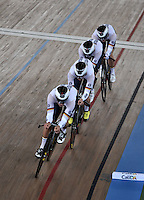 CALI – COLOMBIA – 26-02-2014: Theo Reinhardt, Maximiliam Beyer, Nils Schomber y Kerster Thiele equipo de Alemania durante competencia de Persecucion por Equipos masculino en el Velodromo Alcides Nieto Patiño, sede del Campeonato Mundial UCI de Ciclismo Pista 2014. / Theo Reinhardt, Maximiliam Beyer, Nils Schomber and Kerster Thiele of the Germany team during the test of the Men´s Team Persuit at the Alcides Nieto Patiño Velodrome, home of the 2014 UCI Track Cycling World Championships. Photos: VizzorImage / Luis Ramirez / Staff.