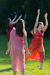 Old Westbury, New York, U.S. - June 21, 2014 - Lori Belilove & The Isadora Duncan Dance Company dances in Greek tunics throughout the gardens during the Midsummer Night event at the Long Island Gold Coast estate of Old Westbury Gardens on the first day of summer, the summer solstice.