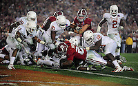 Jan 7, 2010; Pasadena, CA, USA; Alabama Crimson Tide running back Mark Ingram (22) dives into the endzone for a touchdown during the fourth quarter of the 2010 BCS national championship game against the Texas Longhorns at the Rose Bowl.  Mandatory Credit: Mark J. Rebilas-