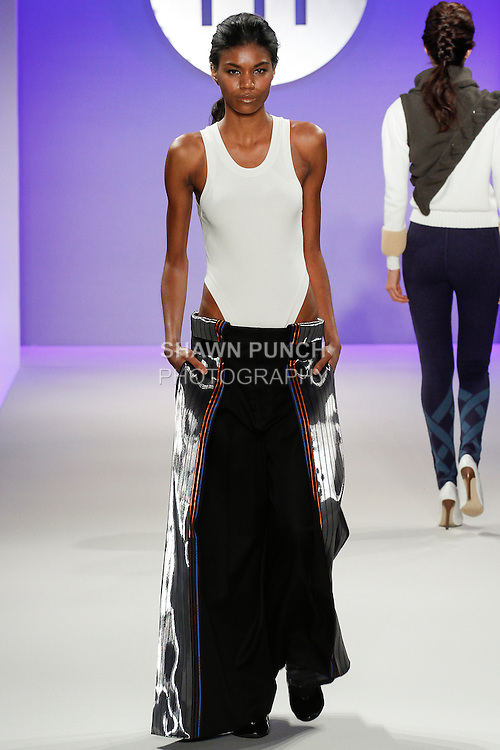 Model walks runway in an outfit by Hannah Kim, during the FIT Future of Fashion 2014 Graduates' Collection fashion show, at the Fashion Institute of Technology on May 1, 2014.
