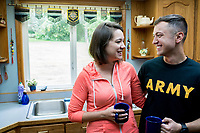 Military couple at home in kitchen; model-released, DoD-complaint for advertising