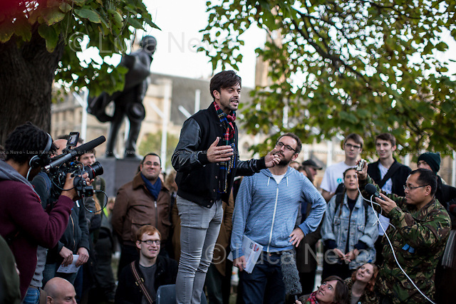Jolyon Rubinstein (One of the creators and presenter of the BBC Satire show &quot;The Revolution Will Be Televised&quot;).<br /> <br /> Day IX - 25.10.2014<br /> <br /> London 17-26.10.2014. A day at the Parliament Square Occupy Democracy Camp in London. Protesters have been camping in Parliament Square since the 17th of October and they will leave on Sunday the 26th. Since the beginning of the direct action protesters have been battling with the MET Police and the Greater London Authority's Heritage Wardens (provided under private contract by AOS Security) over the specific bylaw which applies to a designated area immediately surrounding and including Parliament Square and which bans sleeping equipment. Several people have been arrested, including the Green Party's Baroness Jenny Jones, member of the London Assembly who was later &quot;de-arrested&quot;. In the meantime, numerous celebrities, politicians, experts, activists, and members of the public met for conferences and debates about various topics, from democracy to climate change, to the economic crisis, to corruption, to poetry and many more.<br /> <br /> For more information please click here: http://occupydemocracy.org.uk/ &amp; http://on.fb.me/12tuv79