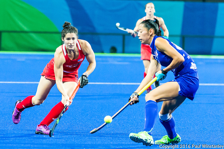 Michelle Vittese #9 of United States passes during USA vs Japan in a Pool B game at the Rio 2016 Olympics at the Olympic Hockey Centre in Rio de Janeiro, Brazil.