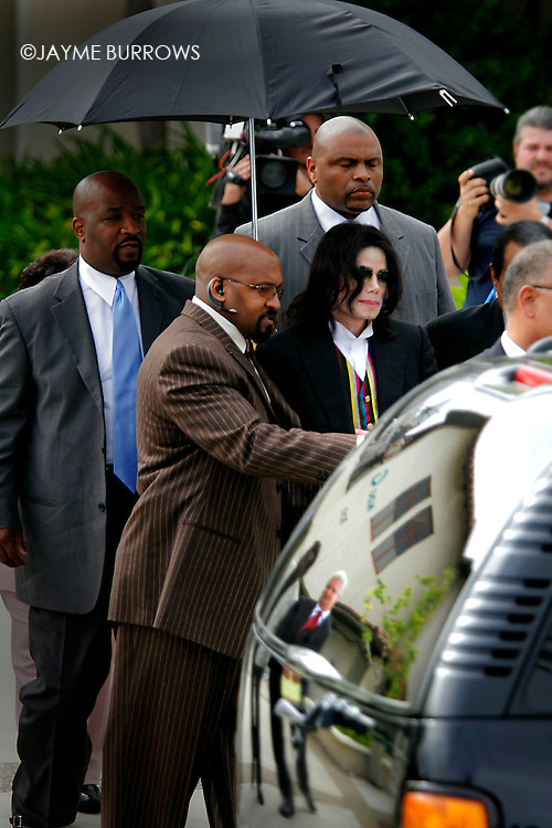 Michael Jackson walks gingerly out of the courtroom after the 16th day of his child molestation trial in Santa Maria, Calif on Monday, March 21, 2005. ..