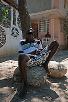 .16 april .Croix des Bouquets.metal work.Serge Jolimeau workshop.working in the yard.metal screens.tree of life.details.tall candle stickBeads and Sequins .bags, purses, wallets, glasses cases, voodoo flags.from Port-au-Prince.