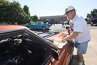 NWA Democrat-Gazette/FLIP PUTTHOFF <br /> RIDE AND SHINE<br /> Mike Maule of Rogers polishes his 1970 Chevrolet Chevelle on Saturday July 7 2018 at the monthly Coffee and Cars event in downtown Springdale. Coffee and Cars takes place the first Saturday of the month April through October along Emma Avenue south of Shiloah Square. Saturday's show had a patriotic theme to honor Independence Day. There's no charge for vehicle owners to enter the car show, and people can vote for their favorite cars and trucks. Winners get plaques, said Jennifor Joyner with Downtown Springdale Alliance.