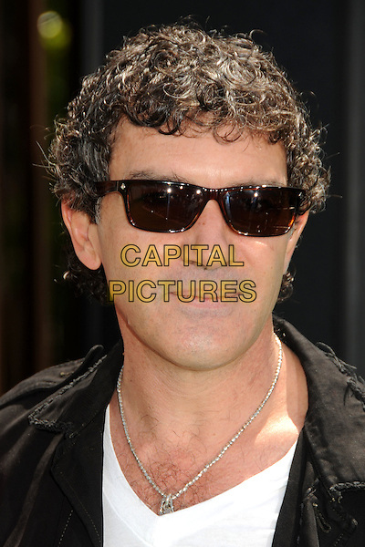 """ANTONIO BANDERAS .Attending the """"Shrek Forever After"""" Los Angeles Film Premiere held at the Gibson Amphitheatre, Universal City, California, USA, 16th May 2010..arrivals portrait headshot black white silver necklace curly hair ray bans sunglasses wayfarers.CAP/ADM/BP.©Byron Purvis/AdMedia/Capital Pictures."""