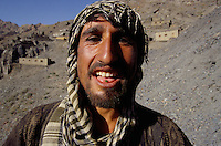 A miner hiding a emerald in is mouth, the best safe in the emerald village at 4000 meters high, in the Panshir valley.