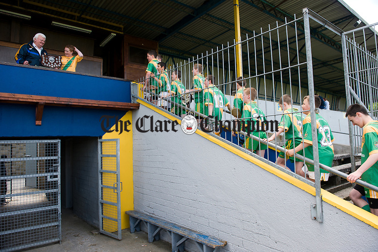 The O Callaghan's Mills team head up the steps for the trophy following their U-14C final win over Bodyke at Cusack Park. Photograph by John Kelly.
