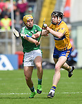 Paul Browne of Limerick in action against Tony Kelly of Clare during their Munster Championship semi-final at Thurles.  Photograph by John Kelly.