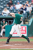 Cody Keefer (23) of the Greensboro Grasshoppers follows through on his swing against the Hagerstown Suns at NewBridge Bank Park on May 20, 2014 in Greensboro, North Carolina.  The Grasshoppers defeated the Suns 5-4. (Brian Westerholt/Four Seam Images)