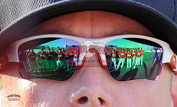 Greenville Drive players are reflected in the sunglasses of first-year manager Darren Fenster (3) as he talks to them on the team's Media Day first workout on Tuesday, April 1, 2014, at Fluor Field at the West End in Greenville, South Carolina. (Tom Priddy/Four Seam Images)